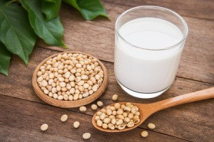 31138259 - soy milk and soy bean on wooden background