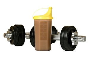 8898761 - protein shake in plastic shaker, with weights, isolated on white